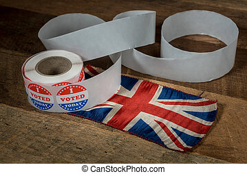Roll of I Voted Today paper stickers on table with UK Flag