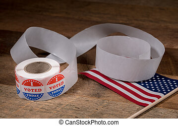Roll of I Voted Today paper stickers on table with US Flag