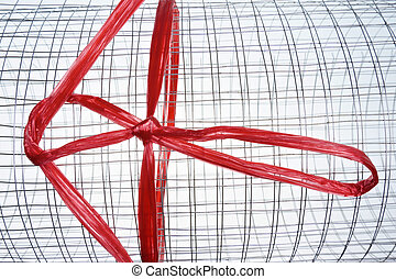 Roll of metal net with red plastic rope