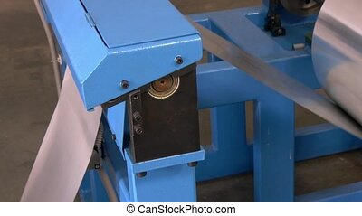 Roll of metal sheets on industrial CNC machine. Automation...