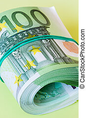 roll of one hundred euro banknotes