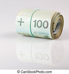 roll of one undred polish zloty bills tied in burlap string...