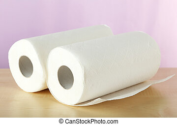 Roll of paper towel on brown wooden background