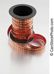 Roll of red, green and gold ribbon