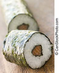 Roll of Salmon Sushi on a Board