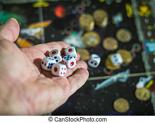 Roll of the dice on the playing field with the coins.