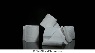 Roll of Toilet Paper Falling on Black Background, Slow Motion