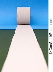 Roll of toilet paper on a colored background