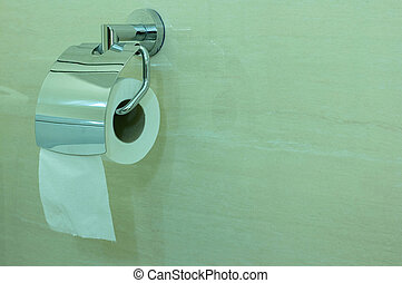 Roll of White Tissue Paper or Toilet Paper Hanging in Bathroom