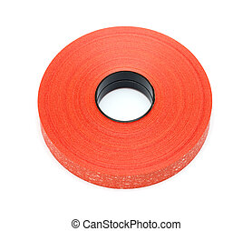 Roll red plastic ribbon on white background