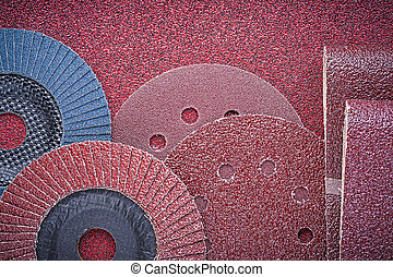 Rolled abrasive paper grinding wheels on polishing sheet