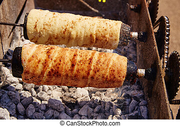 Rolled bakery meat rolls in charcoal