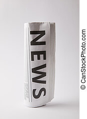 rolled daily newspaper on white background