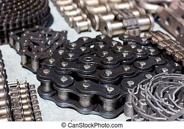 Rolled motor chains - Close up of rolled new motor chains