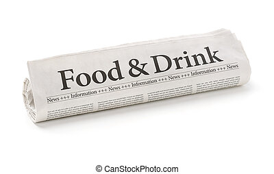 Rolled newspaper with the headline Food and Drink