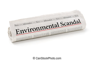 Rolled newspaper with the headline Environmental Scandal