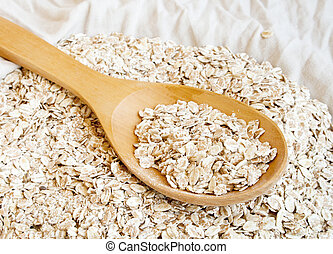 Rolled oats - Dry rolled oats in wooden spoon
