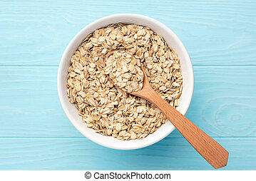 Rolled oats, oat flakes in bowl