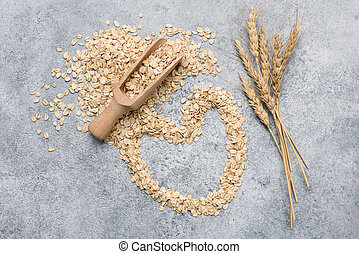 Rolled oats, oat flakes on concrete