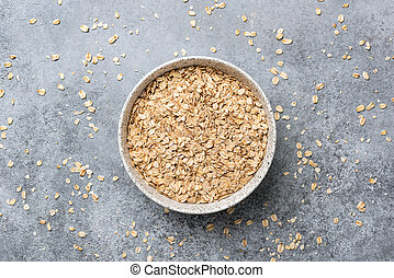 Rolled oats or oat flakes in bowl