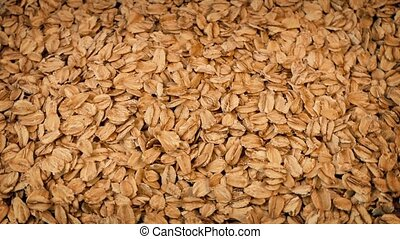 Rolled Oats Rotating - Pile of rolled oats rotating