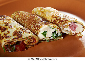 rolled pancakes stuffed ham and cheese. Shallow...