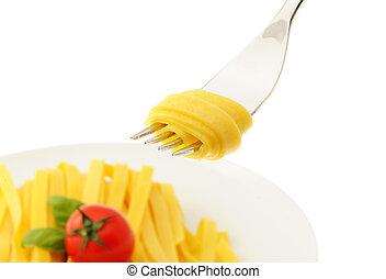 Rolled spaghetti on a fork, italian food