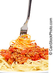 Rolled spaghetti on a fork - Rolled spaghetti with tomato...
