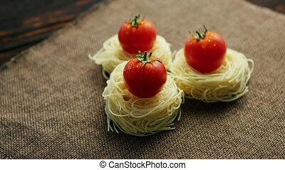 Rolled spaghetti with tomatoes - From above view of...