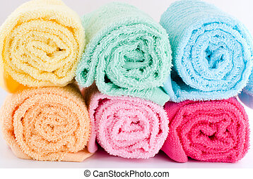 Rolled towels - Multi color of laden rolled towels on a...