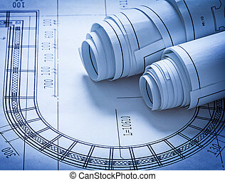 Rolled up construction blueprints building concept