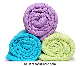 Rolled up duvet - Colorful duvet, isolated.