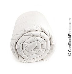 Rolled up duvet - Warm down filled duvet rolled up isolated...