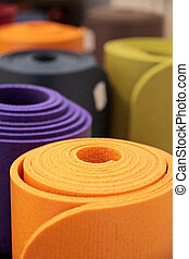 Rolled-up yoga mats - Colorful yoga mats rolled up in a yoga...