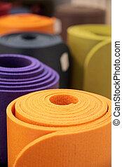 rolled-up, yoga- matten