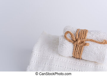 Rolled white towels spa object on white background