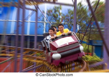 Roller Coaster - Asian people on roller coaster at Genting...
