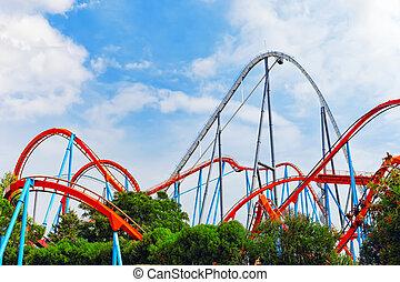 Roller Coaster in amusement park. - Roller Coaster in funny...
