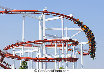 Roller coaster in amusement park.
