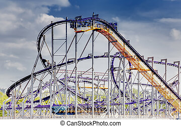 Roller coaster in city amusement park