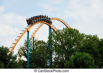Roller Coaster - People on a roller coaster at amusement...