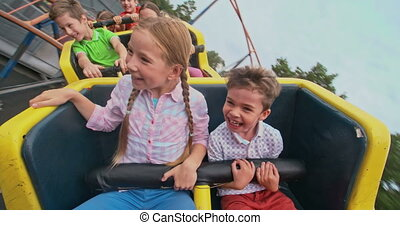 Roller-Coaster Ride - Group of kids shouting while riding a...