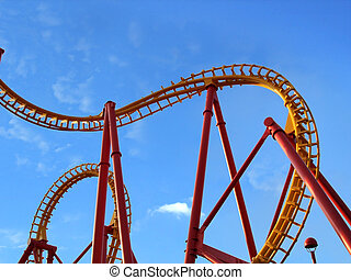 Roller Coaster - View of a roller coaster against blue sky.