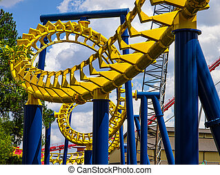 Roller Coster - Theme park Roller Coaster during the day