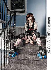 Roller derby girl sitting on stairs
