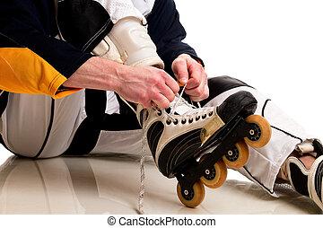 Roller Hockey Player - Roller hockey player. Studio shot...