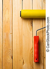 Roller isolated on wooden background