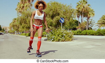Roller Skate Girl Riding Along Tropical Street at Costa del...