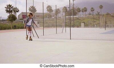 Roller skater balancing on one leg - Expert female roller...