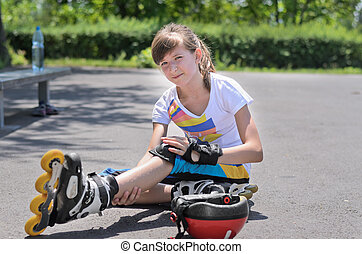 Roller skater looking at her bruised arm
